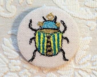 Beetle badge- linen- stitched
