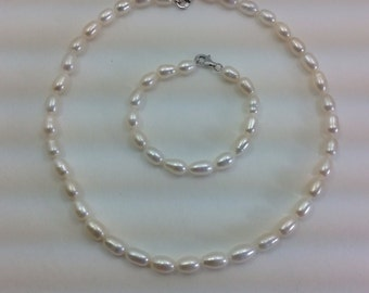 Pearl necklace and bracelet set.