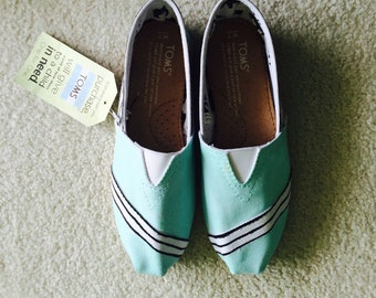 sale item this month Toms size 7w