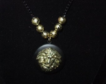 Black & Gold Lion Locket (Gold Beads w/Black Chain)