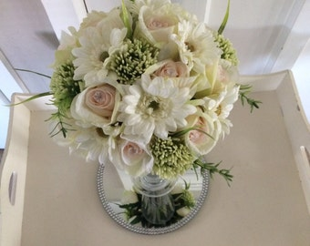 Stunning wedding table centrepieces...tall glass vase with floral display,ivory gerberas, greenery, crystal pins & pink roses