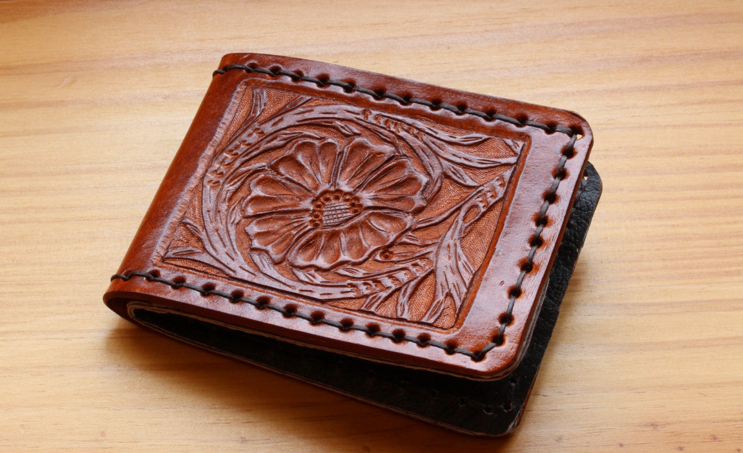Sheridan hand carved leather wallets by