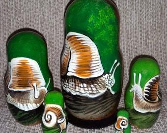Snail on Five Russian Nesting Dolls.