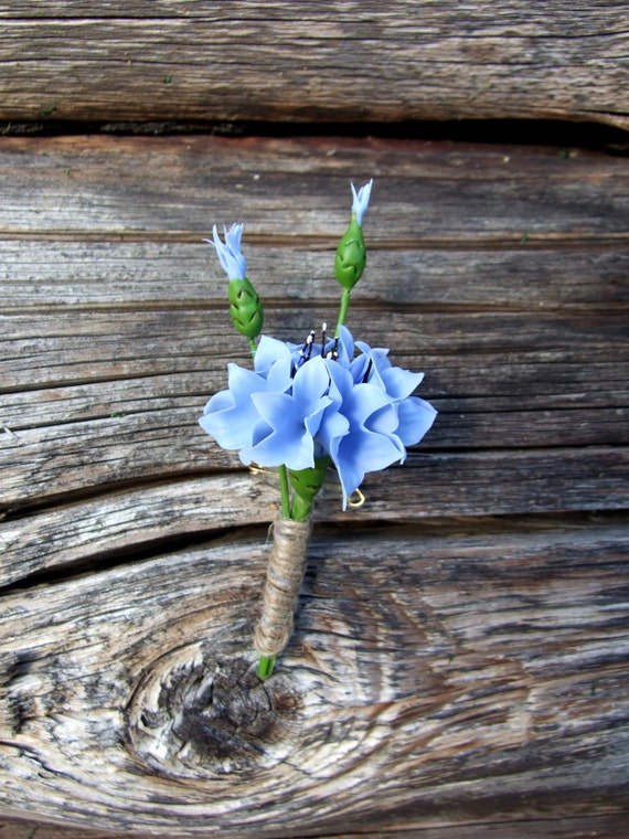 Accessories, jewelry, boutonniere with blue cornflowers