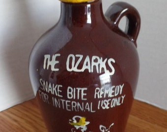 Old hillbilly style souvenir jug.  The Ozarks, Snake Bite remedy, for internal use only.