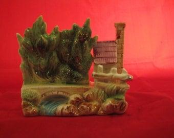 Small dimential glazed pottery piece.
