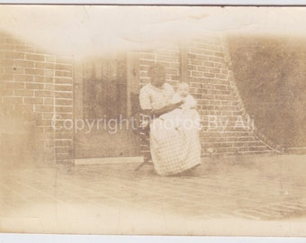 Vintage photo snapshot - In Loving Hands- Older African American woman and baby