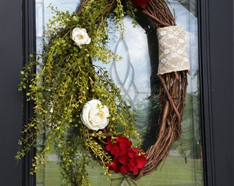 Oval grapevine wreath with flowing greenery