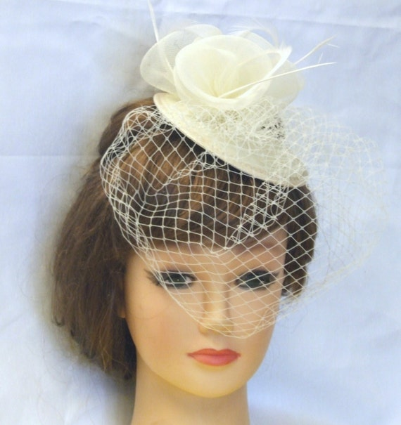 1940s Style Wedding Dresses | Classic Wedding Dresses Vintage 1940s-50s Fascinator Veil Hat White Ivory Tear drop hat  birdcage veilVintage 1940s-50s Fascinator Veil Hat White Ivory Tear drop hat  birdcage veil $30.12 AT vintagedancer.com