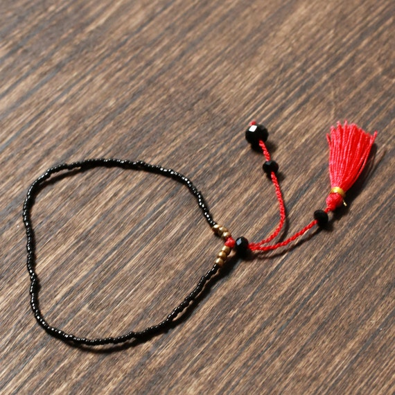 Black and Red Beaded Tassel Bracelet | Bali