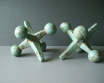 Huge Over sized pair of metal cast Iron Jack sculptures. Mid century decor.