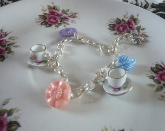 Teacup Charm Bracelet- with Vintage Button, Butterfly and Pearl Decoration