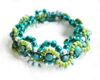 Macrame Bracelet Beaded in seaside shades of aqua,white,and sea green. Micro Macrame Bracelet