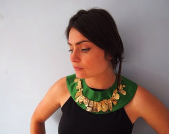 Silk collar with brass necklace detail.