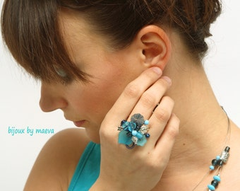 Turquoise jewelry ring turquoise beads and blue flowers and spiral