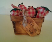 New handmade, primitive, coffee stained basket of strawberries