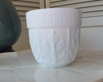 Vintage FTD Flower Vase in White Glass with a Surround of Leaves