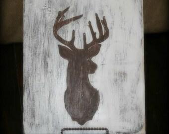 Rustic wood deer silhouette.