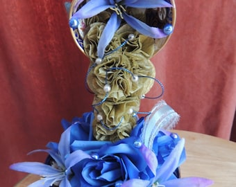 Blue/ gold flying cup with artificial flowers