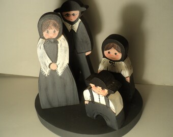 4 pc. amish family carvings