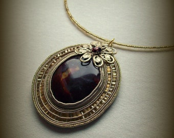 Mineral stone necklace made according to soutache technique