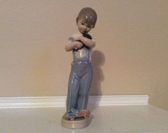 Lladro Mechanic Boy with a Hammer Figurine Retired #4897.