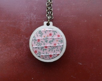 Small floral charity necklace.