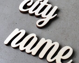 name of a city (up to 8 letters) - wooden lettering