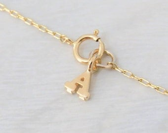 Add a personalized letter charm