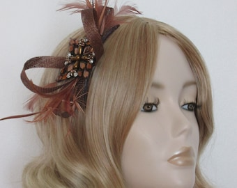BROWN SINAMAY FASCINATOR, Made of Sinamay, Chestnut Feathers and a Jewelled rhinestone, feathers,on a comb