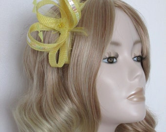 YELLOW and LEMON  FASCINATOR, Made with sinamay, hackle and coque feathers,iridescent sequins, flower, on a 4in comb