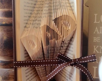 "Set of 4 book folding patterns for ""Dad"" 80-82 folds 3 typography and one image."