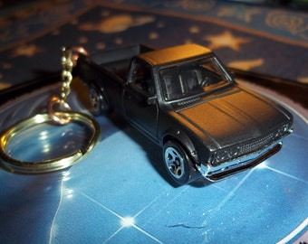 custom made keychain,1972 datsun 620 pick up truck,flat black w/chrome mags/refinished-mint