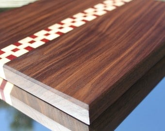 Walnut cutting board with checkerboard accent