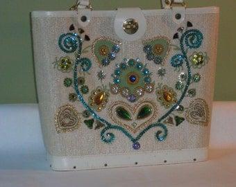 Cabat bag (80) decorated with floral designs in Rhinestones, Miami, to 1950