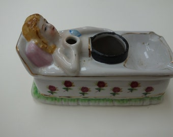 1950's reclining woman ashtray-porcelain