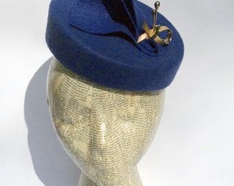 Royal blue pillbox hat with vintage gold pin