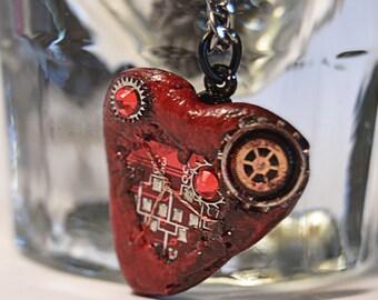 Bionic heart computer jewelry, cyberpunk themed necklace.