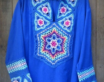 Knitted tunic with crochet appliques