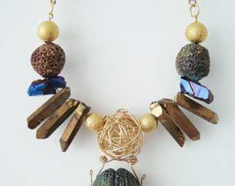 polymer clay and fumed quartz horned dung beetle necklace. miss beetle. fauna collection.