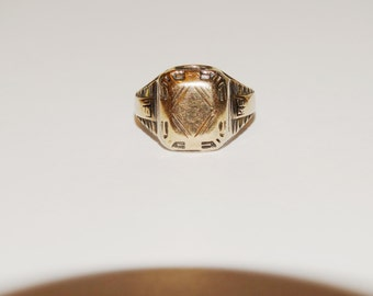 1935 10k/925 Sterling, size 7 Ring.