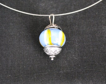 Periwinkle bead on a wire