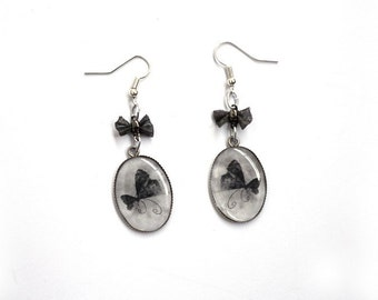 Earrings cameos with moths