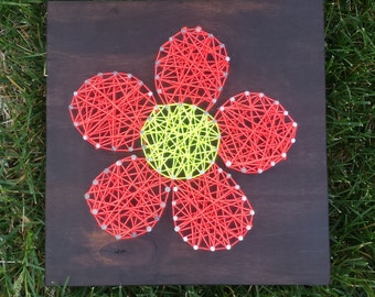 Flower string art on stained wood