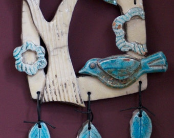 Two birds and a branch wall-hanging