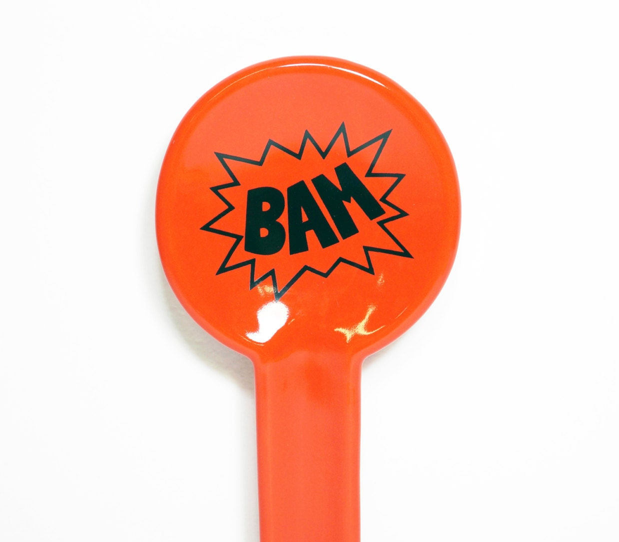 spoon rest with BAM action bubble, shown here in clementine orange - Made to Order / Pick Your Colour