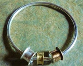 Chunky sterling silver bangle with mixed metal tube charms - Australian made jewellery