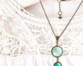 Teal Pendant Necklace, Statement Necklace , Pale Aqua and Teal, Brass Pendant