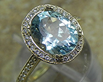 AAA Aquamarine   10x8mm  2.32 Carats   in a 14k Yellow gold ring with diamonds (.32ct) Ring 1821