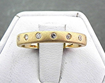 Yellow gold Diamond Band 3mm 14K set with .35 carats of diamonds and finished with a satin finish.